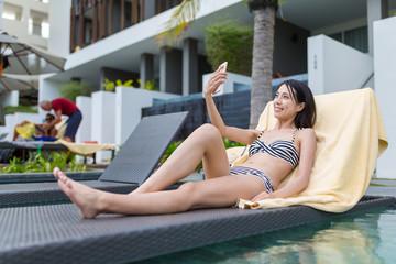 Woman taking selfie and enjoy sunbath