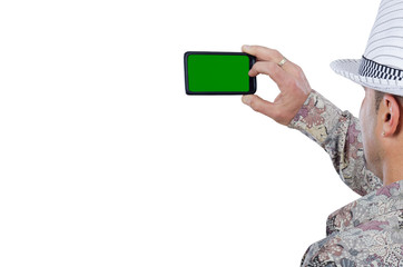 Middle aged man takes a pictures with mobile phone