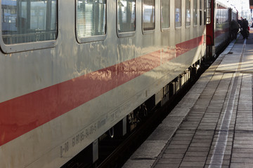 trainstation with symbols and travellers