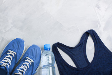 Flatlay sport composition with sport equipment outfit.