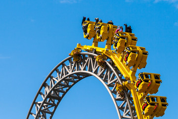 Rollercoaster with yellow carriage in Sarkanniemi Adventure Park, Tampere, Finland