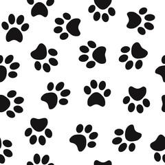 Black animal paw prints seamless pattern vector