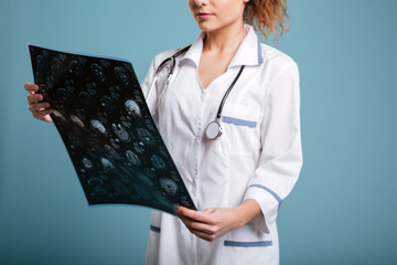 Cropped image of  female doctor holding roentgenogram