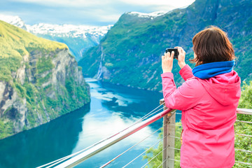 Tourist taking photo from Flydasjuvet viewpoint Norway