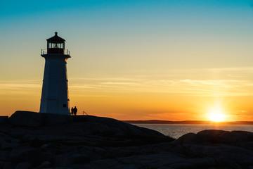 Peggy's Cove Lighthouse, Nova Scotia at sunset.