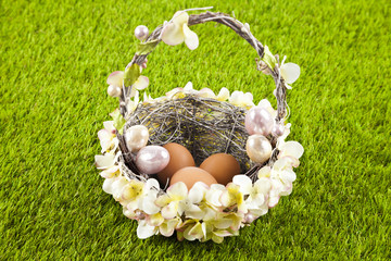 Easter motive. Wicker basket filled with easter eggs