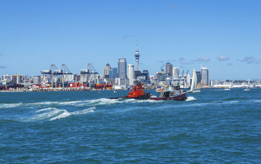 Auckland City View from Devonport Wharf Auckland New Zealand and Old Tugboats