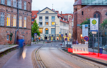 LUBECK, GERMANY - JULY 22, 2016: City medieval buildings. Lubeck attracts over a million visitors annually