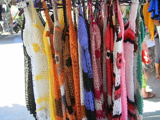 Knitted and crocheted sundresses for sale in a marketplace