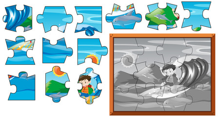 Jigsaw puzzle game with boy surfing