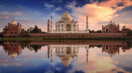 Wall Mural - Scenic Taj Mahal sunset view from Mehtab Bagh on the banks of Yamuna river. Taj Mahal is a white marble mausoleum designated as a UNESCO World heritage site at Agra, India.
