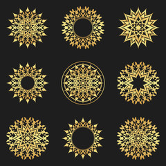 Set of abstract gold flowers, stars..