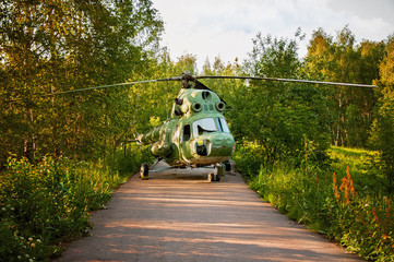 the helicopter made an emergency landing, the woods on the road on a Sunny day