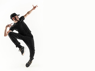 The silhouette of one hip hop male break dancer dancing on white background
