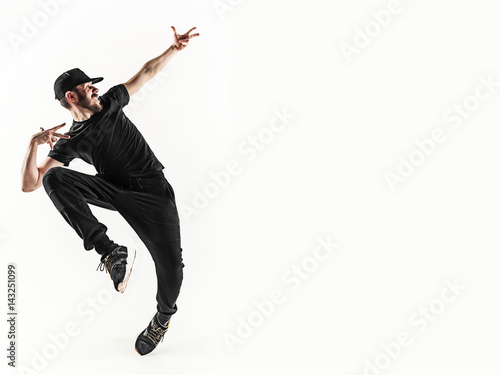 The silhouette of one hip hop male break dancer dancing on