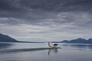 single seaplane starting on a lake in alaska