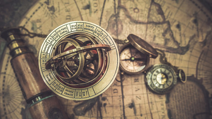 Antique nautical compass and ocean adventure accessory tools.