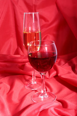 Two Glass of red, white wine on red background