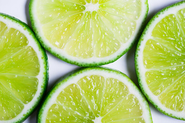 Lime slices background. Citrus