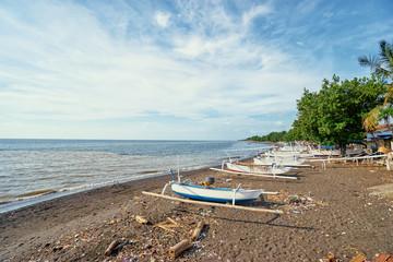 Beautiful landscape. Ocean, beach and indonesian fishing boats.