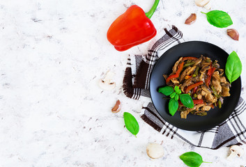 Stir Fry Chicken with peppers and peas on white background. Top view