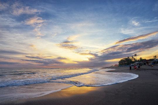 Beautiful landscape. Sunset on the sea shore. Bali, Indonesia.