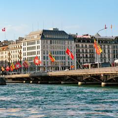 Mont Blanc bridge Swiss flags above Geneva Lake