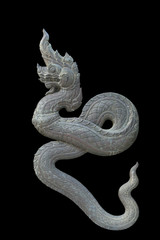 Brass Thai dragon statue isolate on the black background
