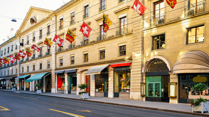 Rue Corraterie Street with Swiss flags of Geneva
