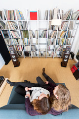 top view of a couple listening to music