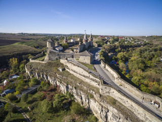 Aerial shot of Kamianets-Podilski castle in Western Ukraine. Taken on a bright clear autumn day with blue skies