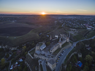 Aerial shot towards a sunset behind Kamianets-Podilskyi castle in Western Ukraine. Taken on a clear autumn evening