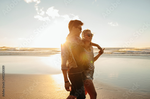 Beautiful young couple together on seashore
