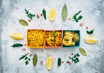 Different Italian pasta on vintage background. Flat lay