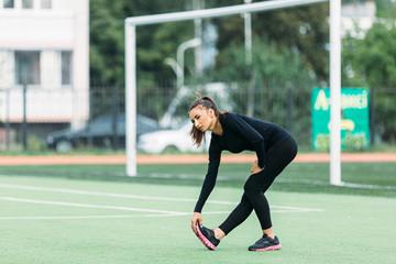 Girl fitness in the stadium