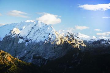 The ridge of Marmolada  mountain in autumn. Marmolada  (3343 m) is a mountain in northeastern Italy, the highest mountain of the Dolomites range, Italy, Europe