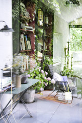 Reflections in the glass of a house and view of the interior decoration industrial and vintage style and garden