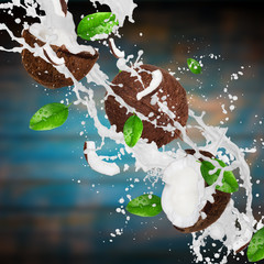 Wall Mural - Coconuts with milk splash over wooden background.