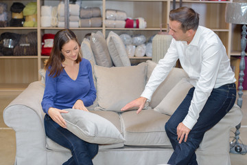 Couple looking at soft furnishings