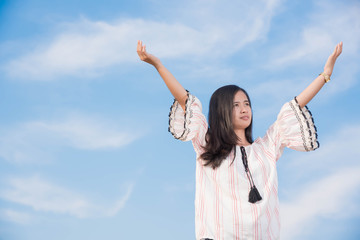 Young woman happy in summer sunlight sky outdoor. summer concept