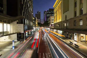 Brisbane CBD night life and traffic light trails, at the intersection of Adelaide and Edward streets.