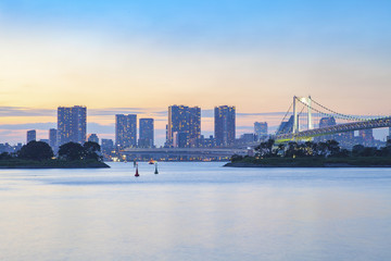 beautiful rainbow bridge and  city scape of odaiba harbor tokyo japan
