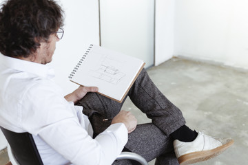 Architect sketching at construction site