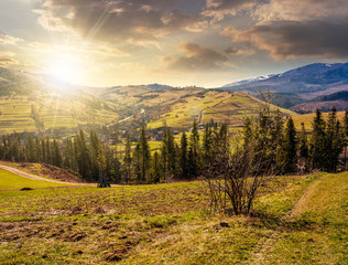mountain rural area in springtime at sunset
