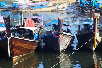 Thai fishing boat parked at dawn pier.
