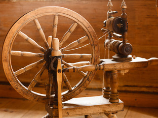 Oldfashioned wooden distaff, spindle, spinning wheel