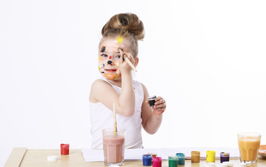 Happy beautiful little girl with painted face