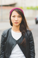 portrait of asian beautiful young woman looking in camera serious - confident, customer, girl power concept
