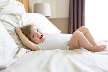 little cute baby girl on the bed