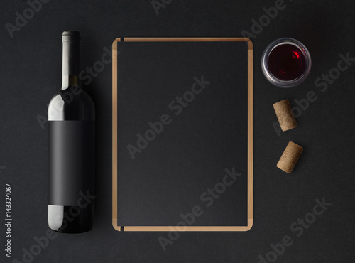 Bottle of red wine with a black label on a dark background, a wine ...